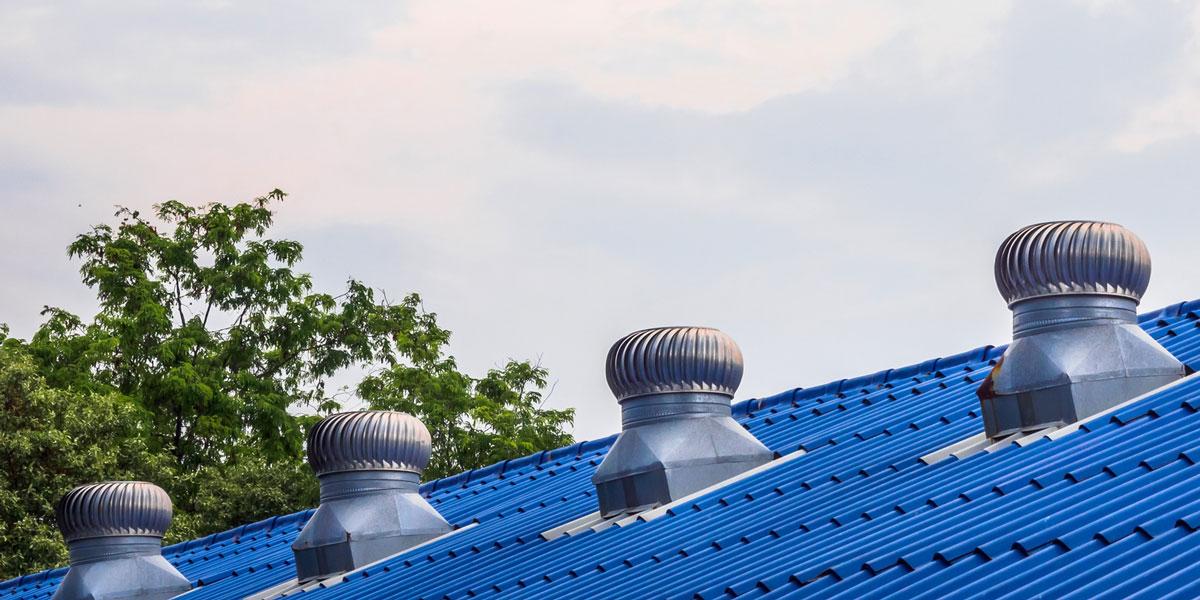 Roof ventilators on a blue roof